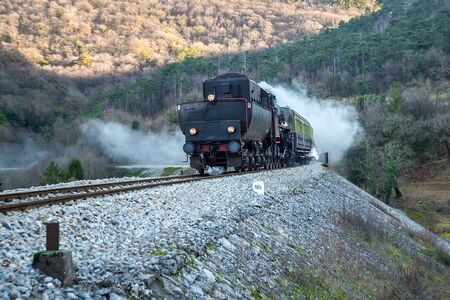 Old steam train near the railway station at  Branik, Slovenia, lots of black and gray steam
