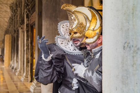 Venice, Italy - February 22, 2017: Single traditional Venetian mask on St. Mark's Square in Venice. Portrait of a man wearing a mask in Venice during the carnival days