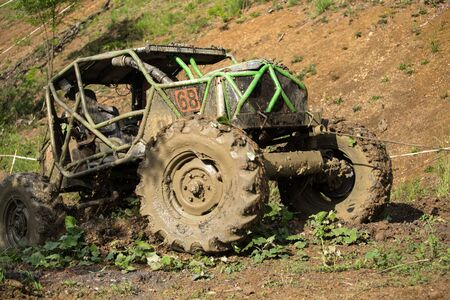 Off road vehicle in the mud Stock Photo