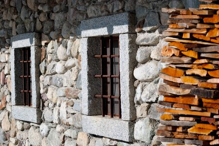 2 stone windows of a chalet Banco de Imagens