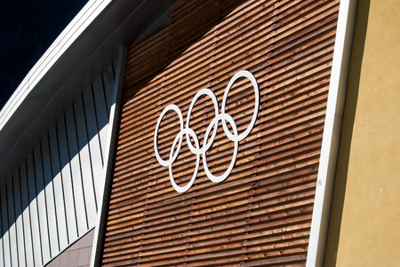 Olympic circles on the wall of the sports hall Redactioneel
