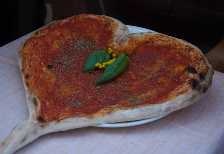 Pizza on a table exposed outside Italian restaurant - Milan
