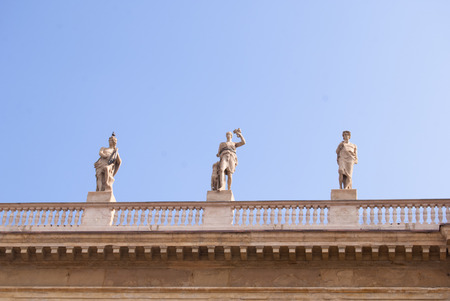 Detail of parapet with white statues of men in Milan
