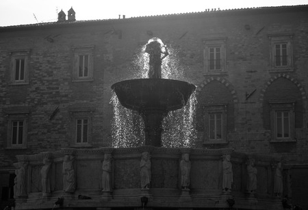 Backlight of watersplash of Major Fountain in the IV November square