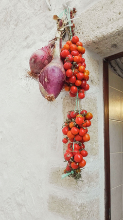 Vegetable hung outside a restaurant kitchen along the way