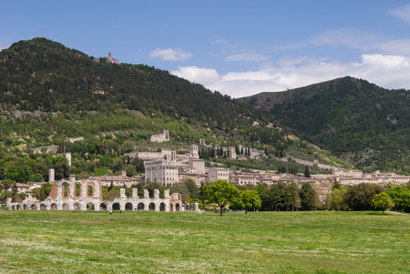 Panorama on historical monuments of Gubbio on the hill Archivio Fotografico - 103307102