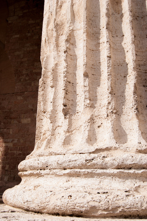 Bottom of the single granite columns in Corinthian style of the facade of the ancient Roman temple of Minerva