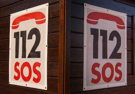 Two SOS numbers hung on the first aid station