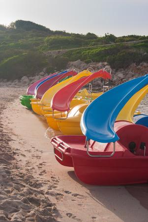 Pedalos on the sandy shoreline of the  Menorca beach 스톡 콘텐츠