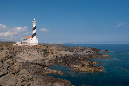 Lighthouse at the east of the island in the middle of a natural reserve in Spain Imagens
