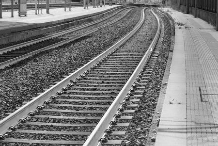 Train tracks and platform at a little station Archivio Fotografico