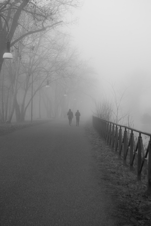 Two women running in the middle of  a fog