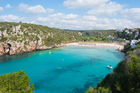 The rocky promontory and the crystalline sea of one of the coves of the minor island of the Balearics in Spain Stock Photo