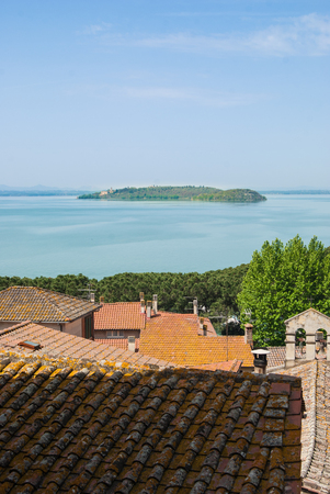 Panorama on Trasimeno lake with little island in the middle