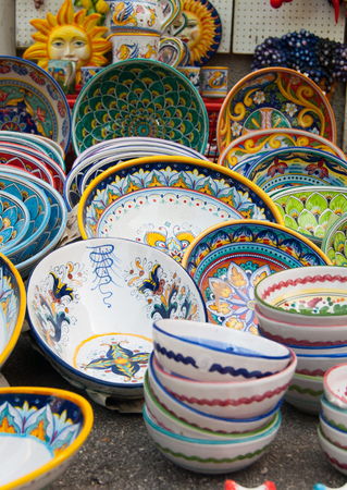 Colorful ceramics showed outside of a souvenirs shops