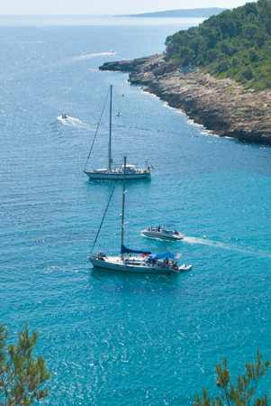 International tourists on vacation on the turquoise sea between the Spanish islands 写真素材