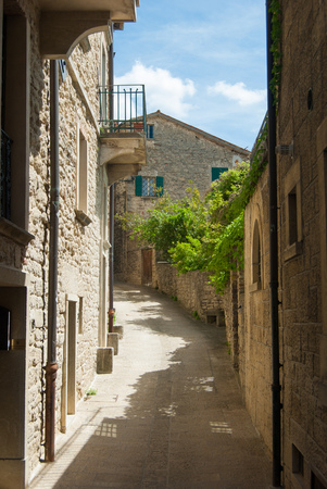 Typical houses with exposed stone walls of San Marino the microstate in the center Italy Stock Photo
