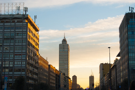 Road with offices buildings in the central station district during the sunset