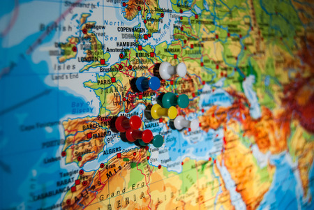 European cities marked by pins on a map during holidays
