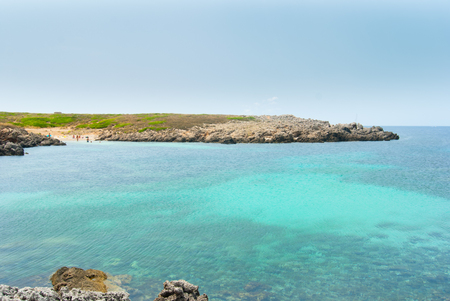 Beautiful and panoramic seascape with small beach of the Menorca spanish island 스톡 콘텐츠