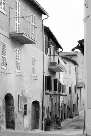 Typical old houses with some windows closed to some open of a town in Umbria