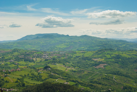 View of the wide landscape with agricultural fields and small villages in the mountains of the central Apennines in Italy 스톡 콘텐츠