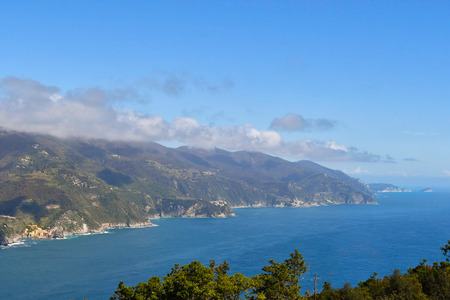 Beautiful stretch of the Italian coast on the Mediterranean sea around La Spezia where you can see four of the five lands during a sunny day 스톡 콘텐츠