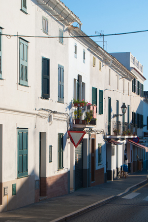 Empy road with typical low and white houses of one of the Spanish islands