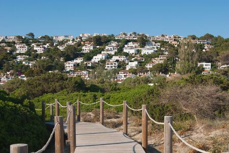 Overview on the city of Sou Bon and wooden walkway on Minorca island
