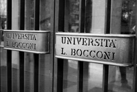 Double handles of the university doors of Managerial economics and legal sciences in black and white