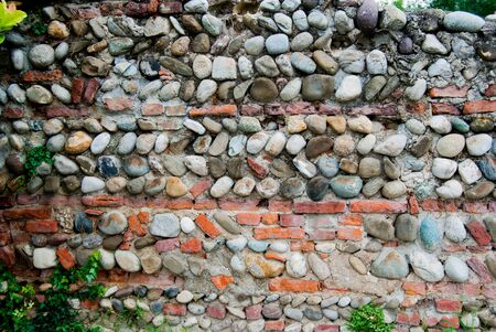 Wall with stones originally dry and put in safety by adding cement
