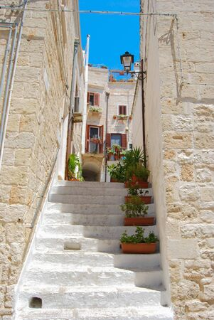 Stairs between the characteristic white houses to access an inner courtyard