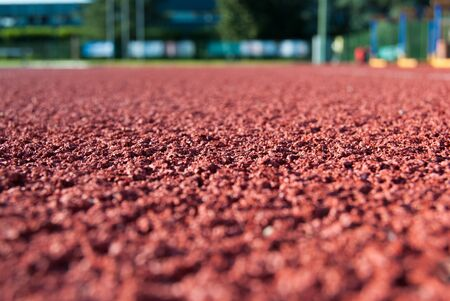 Macro on a granular athletics anti-trauma carpet Stock Photo