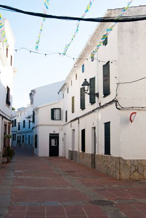 A little road with white houses of El Mercadal of the Spanish islands 스톡 콘텐츠
