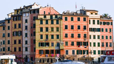 Buildings close to castle and church of a little town on the mediterranean sea in Liguria 스톡 콘텐츠