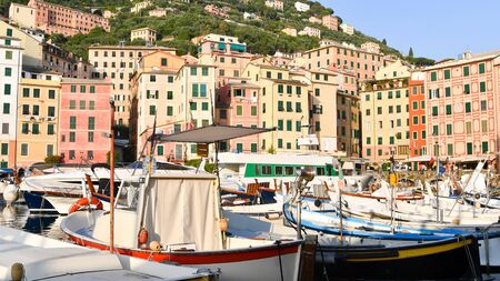 Typical boats and colourful houses of the coastal area on the Mediterranean Sea in northern Italy