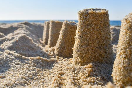 Castle built with sand with warm and light colors on the shoreline seen from below