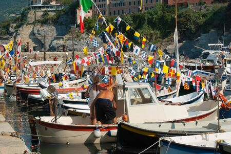 Boats decked out for a Stella Maris a local event in the north of Italy close to Genoa