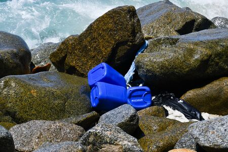 Three blue jerry cans brought from the sea Environmental disaster also for animals marine 스톡 콘텐츠