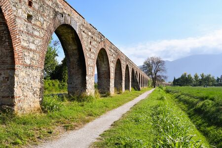 Ancient aqueduct of the 17th centuries in Tucany with little path