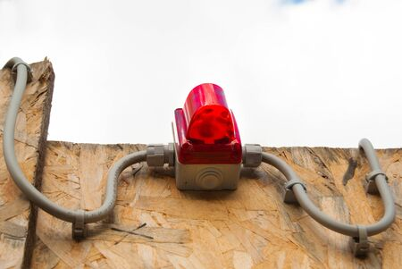 Anti-theft attached to a part of wood delimiting a construction site outdoor