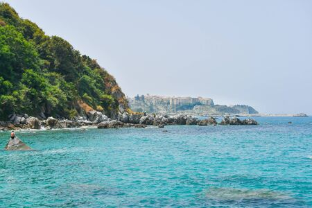 Tuff headland where you see the most famous city of Calabria with crystal clear sea