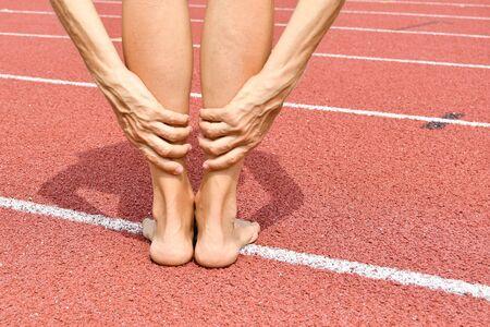Woman without shoes during a moment of muscle stretching