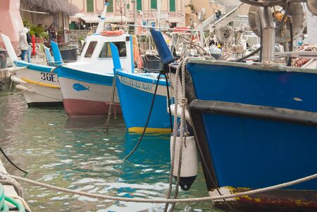Ancient colorful boats and features of the small port of a small town near Genoa on the Mediterranean Sea in northern Italy 스톡 콘텐츠
