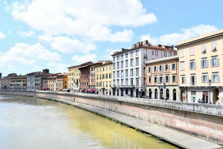 Typical old fashioned buildings next to the river that runs through the Tuscan city in Italy