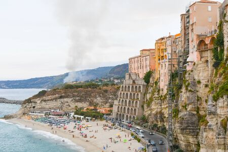 Houses on the rocky cliff and on the beach of the most famous city in Calabria in the south of Italy