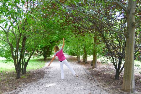 Woman happy and in harmony with nature with mobile phone in her pocket - Small break to enjoy nature without a devices
