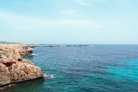 Inlet and outlet on the turquoise sea of Menorca one of the Balearic island in Spain