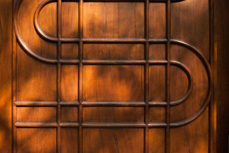 Brown geometric pattern with many curved and straight lines