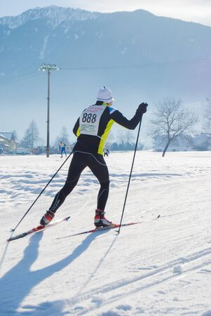 Cross country skier with competition number during a race in a mountain 스톡 콘텐츠